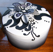 Black to white gradient box with black and white floral design on top